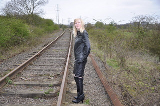 girl in leather boots and leather pants